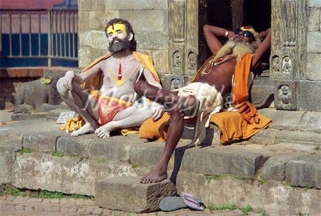 two sadhus lying